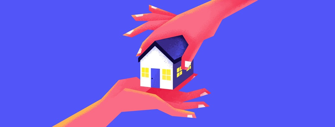a small house being held between two hands