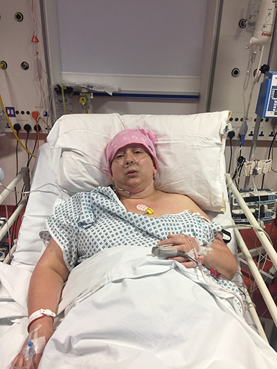 woman lying in hospital after surgery