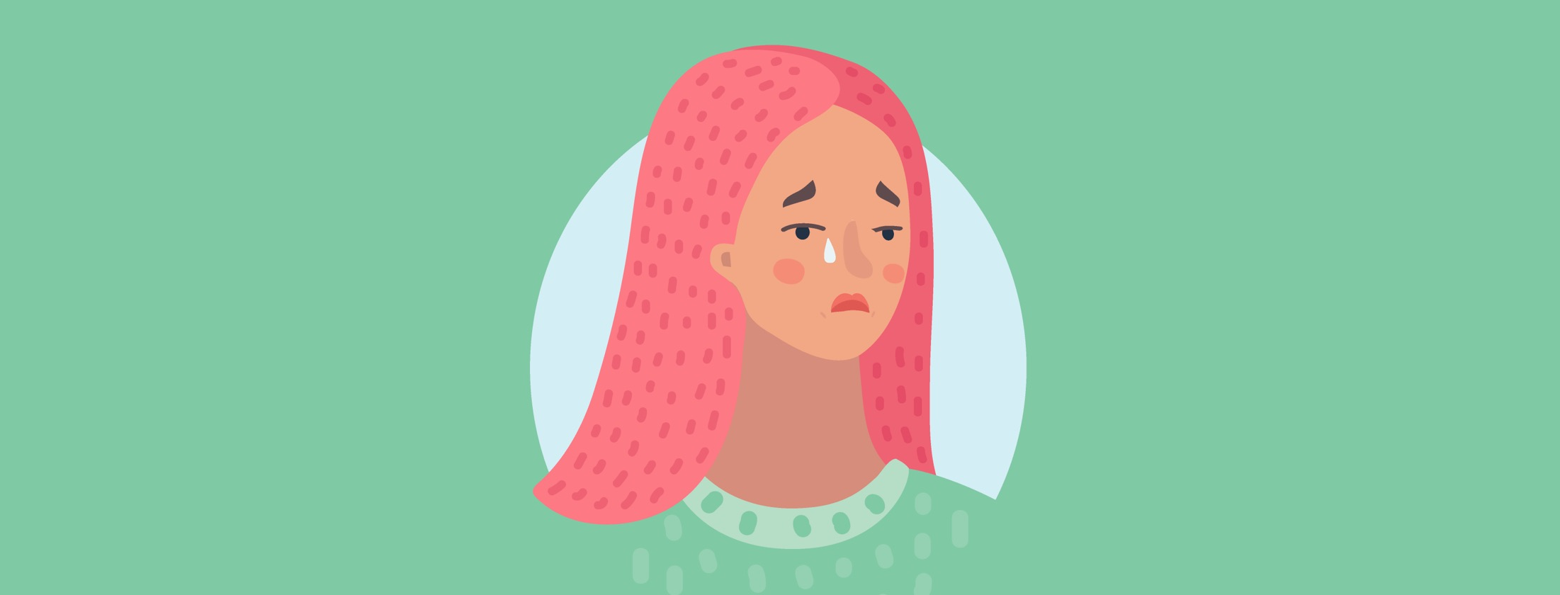 woman with pink hair and green shirt shedding a tear
