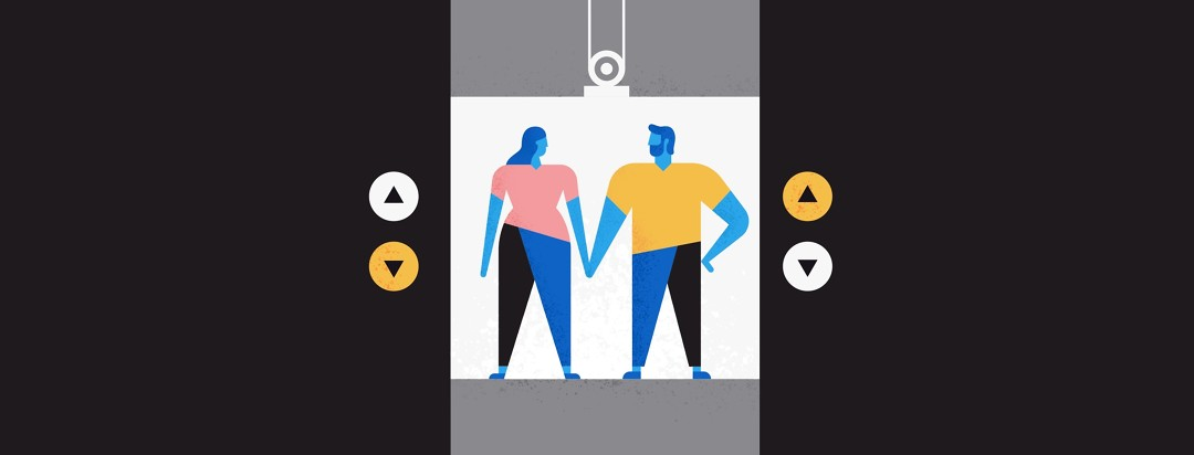 a couple holding hands in an elevator