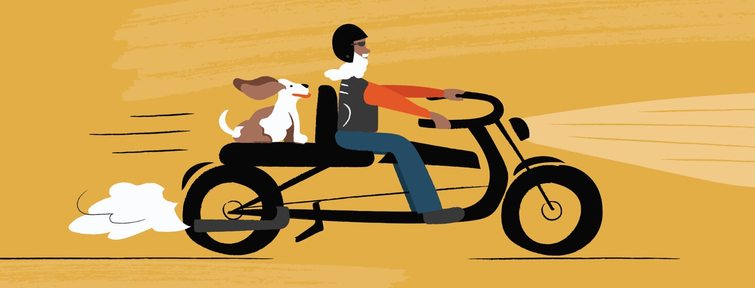 Man and dog on motorcycle