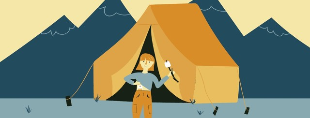Woman camping, standing outside of her tent showing her stoma and holding a marshmallow on a stick