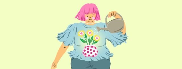 A woman watering heart shaped flowers growing inside her