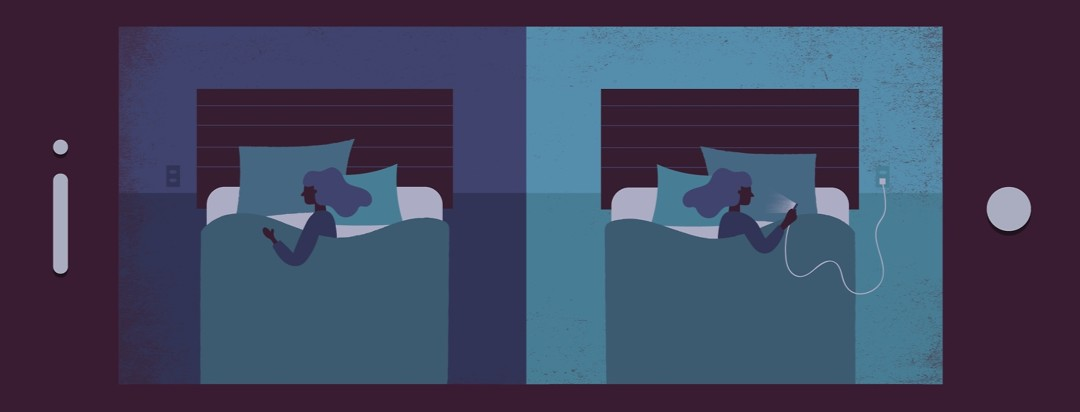 two women lying in bed one is awake and on her phone and the other is sleeping soundly in the dark