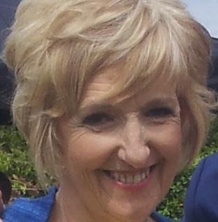 Liz smiles