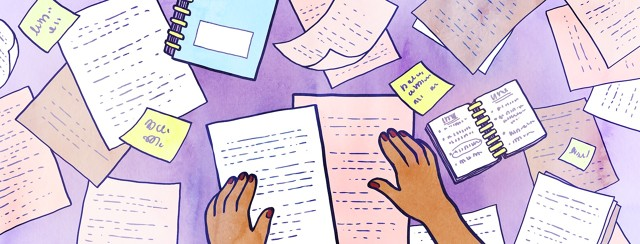 A person's hands sort through a mess of papers and notes on a table.