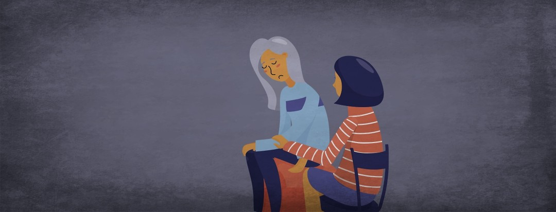 An older woman is comforted by a younger one.