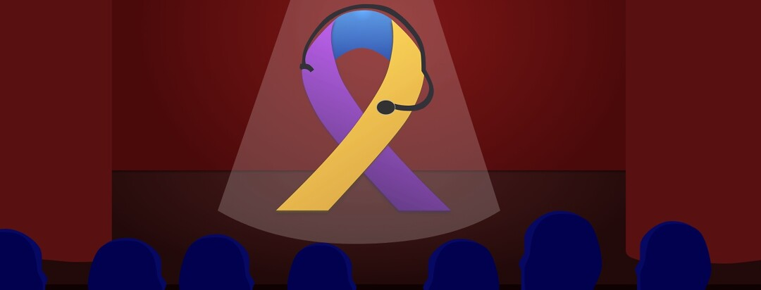 A tricolor bladder cancer awareness ribbon in the spotlight on a stage.