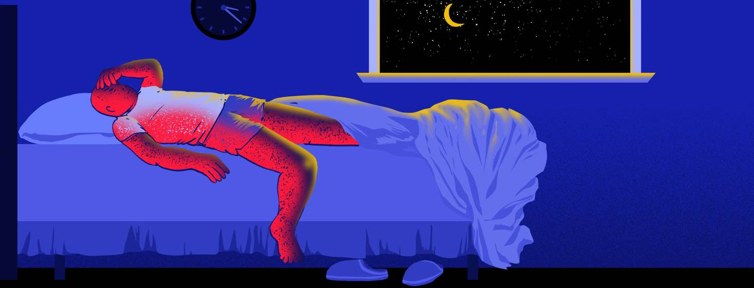 Man lying in bed uncomfortably.