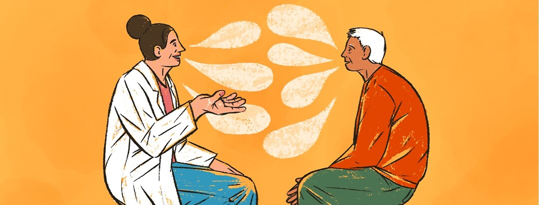 doctor and patient converse across from each other